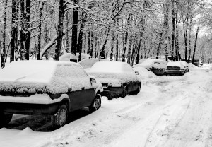 Cars under snow in black and white