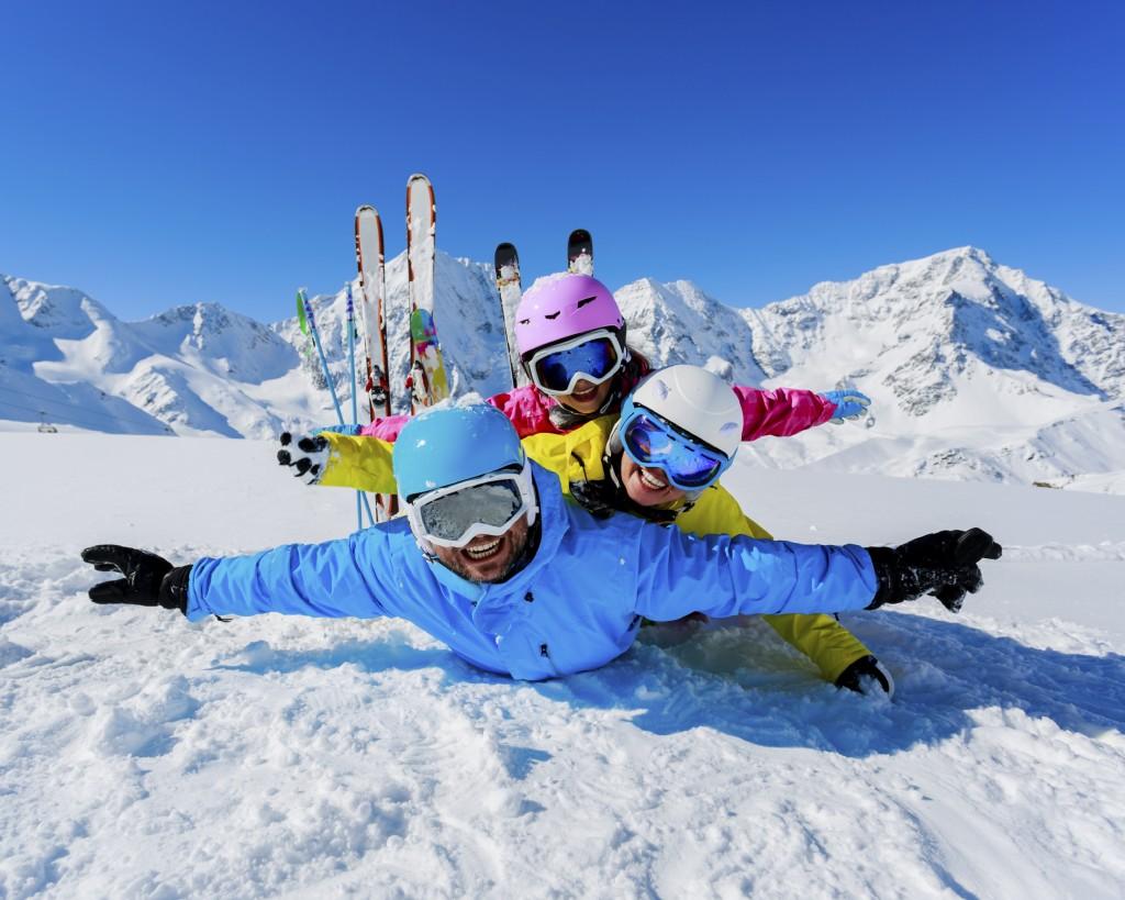 Skiing, winter, snow,  skiers, sun and fun - family enjoying win